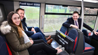 The 'Feet Seat' concept is demonstrated by Zoe Gibbons from Go North East's Customer Services team and Stephen King, Commercial Director, along with Managing Director Martijn Gilbert (right).