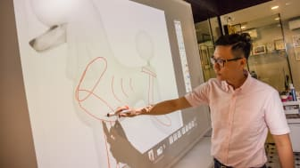 Kingsly Tan, co-founder Animal Arts Academy, says pet grooming lessons are now more fun and engaging with the Epson EB-1430Wi interactive projector. Students and instructors can use their fingers and interactive pen for their poodle drawings.