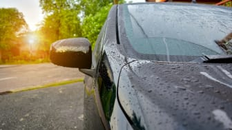 Water droplets evaporating on the surface of a car