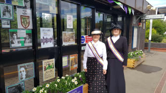 Station adopters at Widney Manor station show off a seasonal display at the station