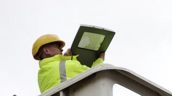 Street lighting supervisor Paul Birchall installs an LED light.