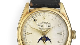 """Rolex: A gentleman's wristwatch of 18k gold, ref. 6062 """"Stelline"""". Automatic movement with triple calendar and moon phase. Movement no. 32883. Circa 1953. Hammer price: 1,527,500 (€ 205,000) including buyer's premium."""