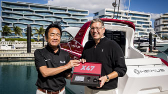Yanmar's Ken Araki and Christopher Anand of NEXUS with the X47 Express Cruiser