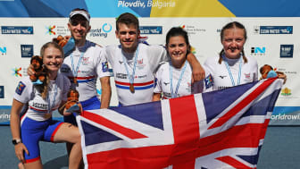 Ellen Butrick (far right) with her teammates winning gold at the World Championships. Photo credit: British Rowing/Naomi Baker