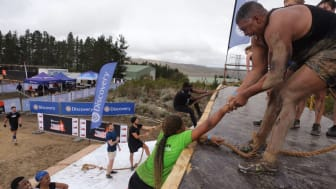 Tough Mudders overcoming Everest presented by Discovery.