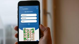 MyDesk-2021 mobile app in hand