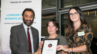 London Assembly member Dr Onkar Sahota presents the award to London Sport's Susan Hutton and Laureece Simmons