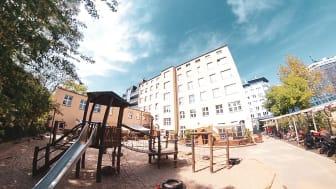 Gartenansicht des BCS-Kindergartens in Berlin.