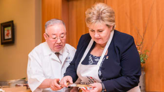 Norwegian Prime Minister Erna Solberg learns the art of sushi making from chef Tsutomu Shimamiya