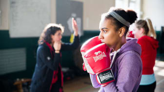 Young woman in a community boxing gym