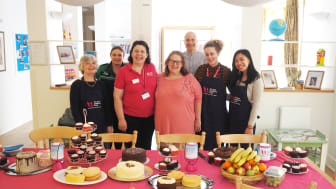 Staff and volunteers put their pinnies on to raise money at their Big Chocolate Tea event.