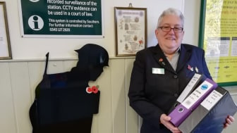 Laura Lee pictured with her research into Brighton railway workers who served in the Great War