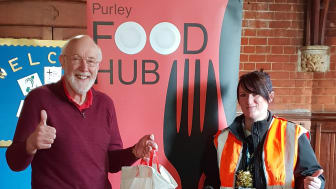 181217 Southern driver Laura McDonald and food bank administrator Steve Hunt, with the donations for Purley Food Hub