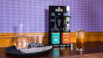 Dilmah Elixir Svart Plexiställ med information om produkten.