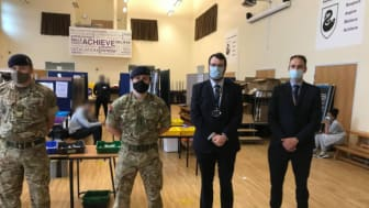 In action at Parrenthorn – soldiers from the 5th Regimental Royal Artillery, with council leader Eamonn O'Brien and deputy head teacher Allen Hall.