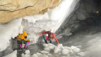 Dr Sebastian Breitenbach exploring possible passages in an ice-filled cave in Siberia