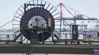 A Cavotec motorised cable reel on an STS container crane