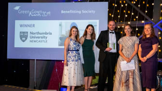 Northumbria's Rachel Dunn, Kayliegh Richardson, Paul McKeown, and Elizabeth Passey receiving the award from the Green Gown host