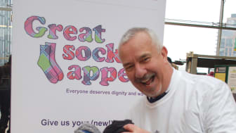 Welcome winter warmers: Spires' charity CEO Nigel Carpenter was delighted with the overflowing container of socks at East Croydon station