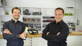 Thomas Wagner (left) and Alain Blind accepted the iF Design Award for the LEXION combine harvester.