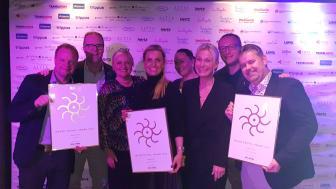 Norwegians salgsteam med de tre prisene fra Grand Travel Awards
