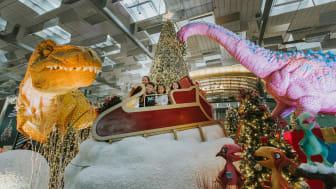 Capturing a moment among ginormous dinosaurs at Terminal 3's festive display Dino Wanderland