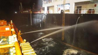 'Esvagt Omega' in firefighting operation at the tanker Alia, 20 October 2015