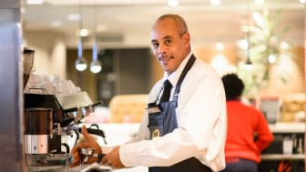 Image: Change Please barista Kingsley Young in the Virgin Trains' First Class Lounge at Euston