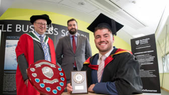Business graduate Joel Tate with Richard Talbot-Jones from NIBE and Professor Philip Shrives from Northumbria