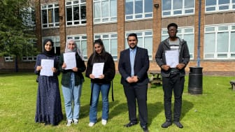 Celebration day – Cllr Tamoor Tariq meets students at his former school, The Derby High in Bury.