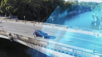 När man kör in i en eDrive-zon ställs bilen om till helt elektrisk körning.