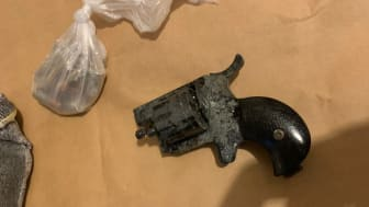 [Image of recovered firearm and ammunition]