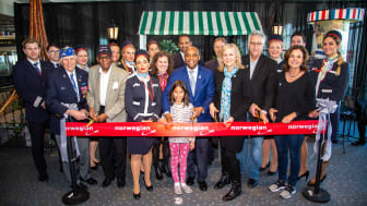 Denver Mayor, Michael Hancock, Airport CEO, Kim Day, Honorary Consul of France, Jeffrey Richards, Norwegian's Head of NA Marketing, Marina Suberlyak, Norwegian flight attendants and other guests at the inaugural celebration