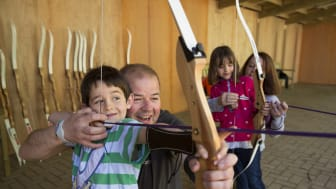 Children master their skills at the Robin Hood and Little Johns Archery session