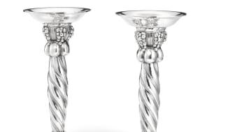 Georg Jensen: A pair of silver candlesticks