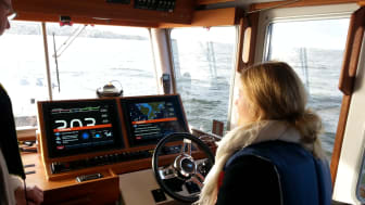 The picture above shows one of the students trying her hand at driving a boat using a joystick (to her right and not visible in the picture).