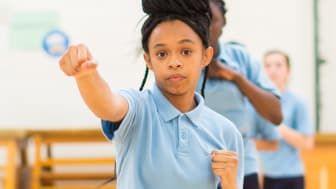 A young girl takes part in a karate lesson