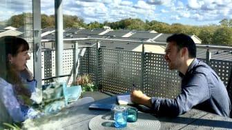 Ellen McKnight and Luke Mintz on Ellen's balcony.
