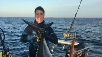 Fish Tales skipper Mark Manchip with his world-record 117kg bigeye tuna