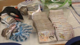 £15m fraud gang jailed - £98,990 of the seized cash