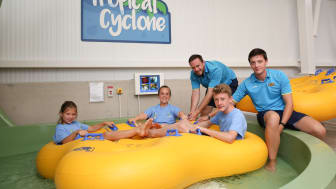 Ellie Simmonds and children from the local swimming club about to ride Tropical Cyclone.