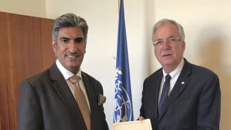 Charge d'Affaires of the Kuwait Embassy in Rome Advisor Salem Al-Zamanan presents Daniel Gustafson, Deputy Director-General (DDG) of the Food and Agriculture Organization of the United Nations, with Board of Trustees Invitation.  in Rome