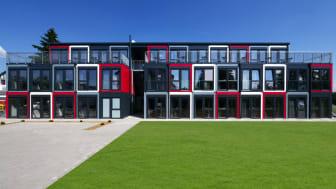 Architektur und Farbkonzept vom Snooze Campus versprechen hohen Wohnkomfort – ganz mobil. Foto: Algeco / freier Architekt BDA Jens J. Ternes, Koblenz.