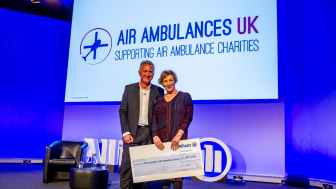 Jon Dye, Allianz's CEO presenting the cheque to Liz Campbell, Chairman of Air Ambulances UK