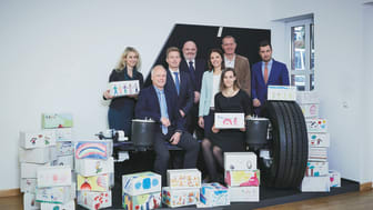 """The campaign """"Give a box, give a smile"""" was spearheaded by (from left to right) Kerstin Petermann, Guido Eyer and Achim Kotz (BPW), Michael Lang (OLS), Renate Kotz (Re:Help), Kira Fink and Peter Schneider (BPW), and Navid Thielemann (OLS)."""