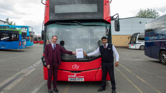 Phil Southall presents Asim Ali with his Oxford Bus Company Star of the Month award