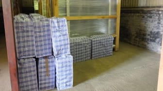 Laundry bags and window frames were packed with illegal cigarettes
