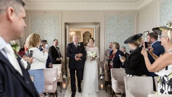 Rochdale stroke survivor walks daughter down the aisle after being left paralysed
