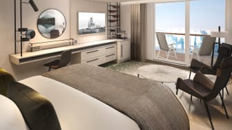 Ample workspace both inside the cabin or on the balcony onboard MS Roald Amundsen's Balcony Suites.