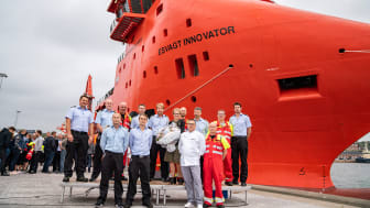 The crew in front of the top modern vessel 'Esvagt Innovator'